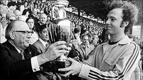 Franz Beckenbauer receives the trophy after his team beat the USSR in the final