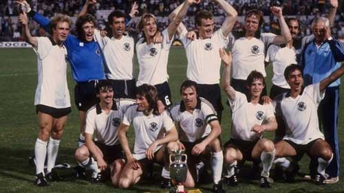 West Germany celebrate with the trophy after beating Belgium